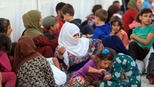 Syrian displaced families, who fled violence after the Turkish offensive in Syria, are seen at a refugee camp in Bardarash on the outskirts of Dohuk, Iraq October 25, 2019 - Sputnik International