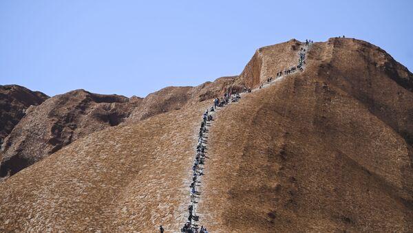 Tourists climb Uluru, formerly known as Ayers Rock, at Uluru-Kata Tjuta National Park in the Northern Territory, Australia, October 25, 2019. Friday is the last day people will be able to climb Uluru - Sputnik International