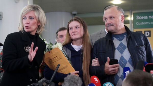 Russian Foreign Ministry's spokeswoman Maria Zakharova, convicted Russian agent Maria Butina, who was released from a Florida prison and then deported by U.S. immigration officials, and her father Valery Butin speaks to the media upon Butina's arrival at Sheremetyevo International Airport outside Moscow, Russia.  - Sputnik International