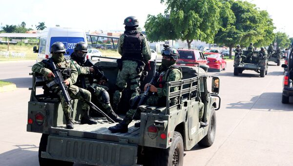 Members of a special unit of the Mexican Army conduct a patrol as part of an operation to increase security after cartel gunmen clashed with federal forces, resulting in the release of Ovidio Guzman from detention, the son of drug kingpin Joaquin El Chapo Guzman, in Culiacan, in Sinaloa state, Mexico October 19, 2019 - Sputnik International