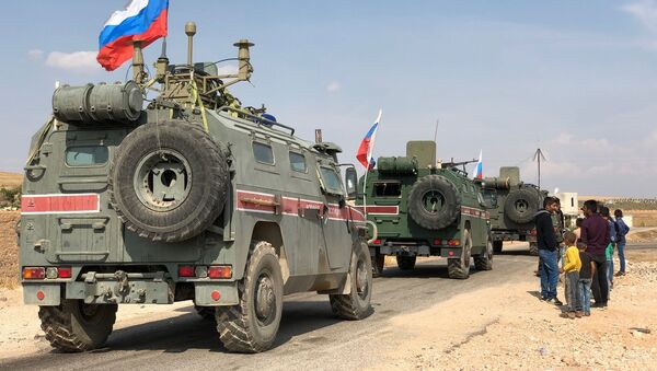 A Russian military police armored vehicles are pictured in the Syrian-Turkish border town of Kobani, Syria - Sputnik International