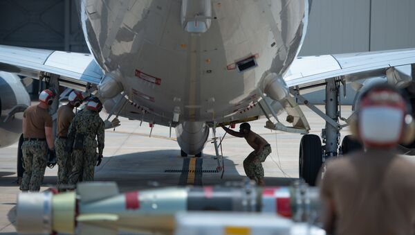 Aviation Ordnanceman 3rd Class Jermain Snowden, assigned to Patrol Squadron (VP) 30, prepares to load a Mark 54 Torpedo onto a P8-A Poseidon aircraft during a training exercise at Naval Air Station Jacksonville - Sputnik International