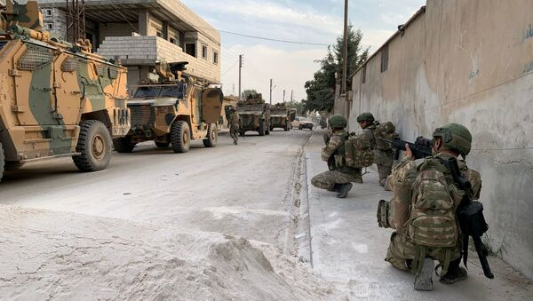 Turkish soldiers are seen in the border town of Tal Abyad, Syria, in this undated handout photo released by Turkish Defence Ministry on October 17, 2019 - Sputnik International