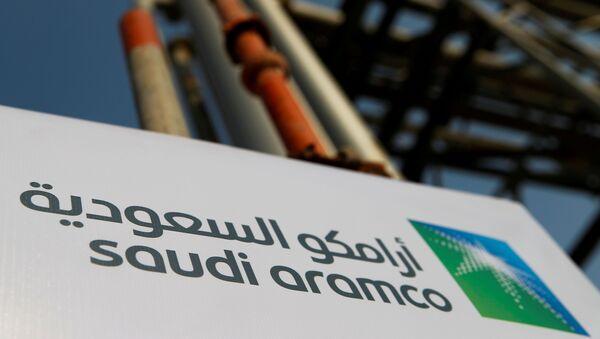 The Saudi Aramco logo is pictured at the company's oil facility in Abqaiq, Saudi Arabia, October 12, 2019 - Sputnik International