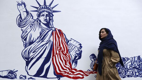 A woman walks past a satirical drawing of the Statue of Liberty after new anti-US murals were unveiled on the walls of the former US embassy in a ceremony in Tehran, Iran, Saturday, 2 November 2019.  - Sputnik International