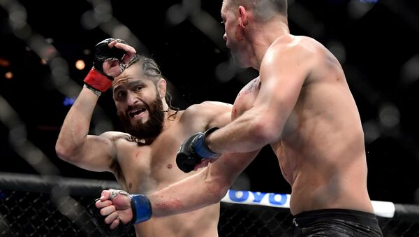 Nate Diaz of the United States (R) fights against Jorge Masvidal of the United States in the Welterweight BMF championship bout during UFC 244 at Madison Square Garden on November 02, 2019 in New York City. - Sputnik International