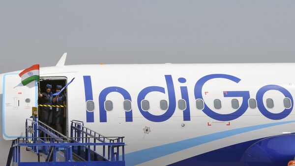 (FILES) In this file photograph taken on March 16, 2016, crew members of an IndiGo Airbus A320 aircraft wave an Indian national flag at The India Aviation 2016 airshow at Begumpet Airport in Hyderabad. Airbus announced on October 29, 2019, that India's IndiGo have ordered 300 A320neo aircraft. - Sputnik International