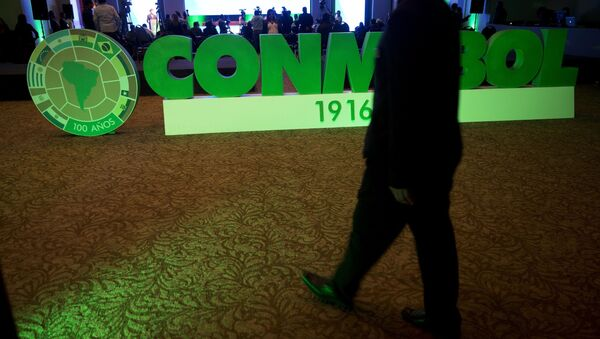 A member of the South American Football Confederation, CONMEBOL, walks in the hotel lounge where the CONMEBOL congress is taking place in Lima, Peru - Sputnik International