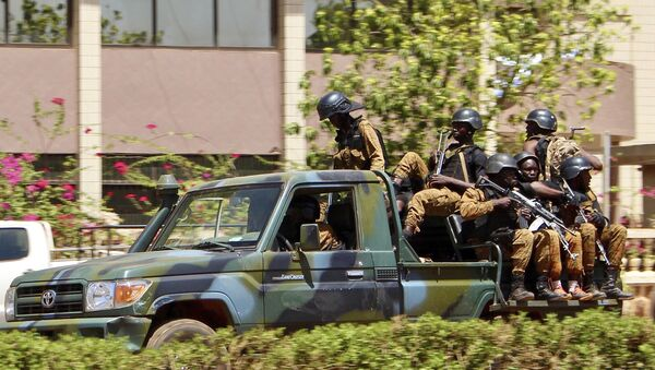 Troops ride in a vehicle near the French Embassy in central Ouagadougou, Burkina Faso - Sputnik International