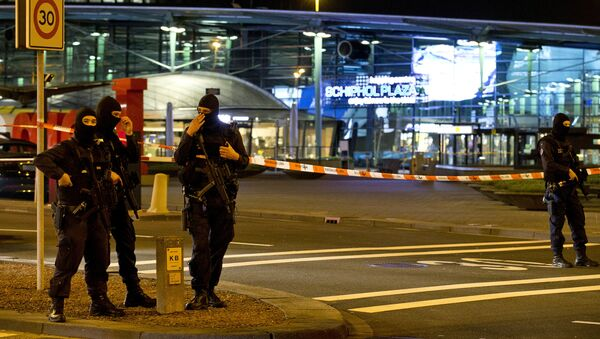 Hooded security forces guard a part of Schiphol Aiport in Amsterdam, Netherlands - Sputnik International