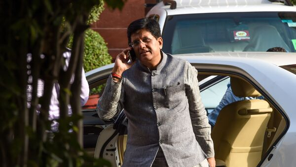 Indian minister of Railways and Commerce and Industry Piyush Goyal talks on the phone as he arrives to attend a meeting with the newly-named cabinet in New Delhi on May 31, 2019 - Sputnik International