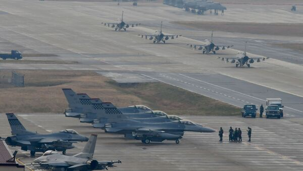 U.S. Air Force F-16 Fighting Falcon fighter aircraft, assigned to the 36th Fighter Squadron, participate in an elephant walk during Exercise VIGILANT ACE  - Sputnik International