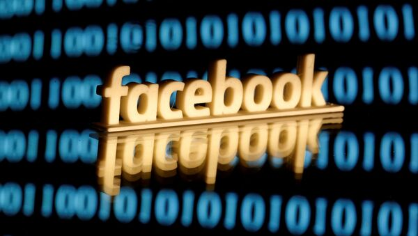 A 3-D printed Facebook logo is seen in front of displayed binary code in this illustration picture, June 18, 2019 - Sputnik International