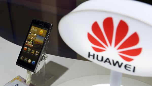 A mobile phone made by Chinese telecom equipment maker Huawei is displayed in a store in Beijing on August 3, 2015. Two Chinese smartphone makers pushed US technology giant Apple into third place in the world's biggest market in the second quarter, an independent analyst firm said on August 3.  - Sputnik International