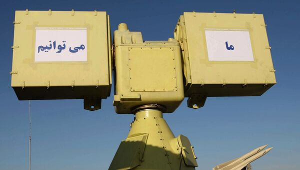 A picture shows a part of Iran's new medium range anti-aircraft air defence system Mersad (Ambush) and a Shahin (Hawk) medium range anti-aircraft missile (R) during a ceremony in Tehran on April 11, 2010 - Sputnik International
