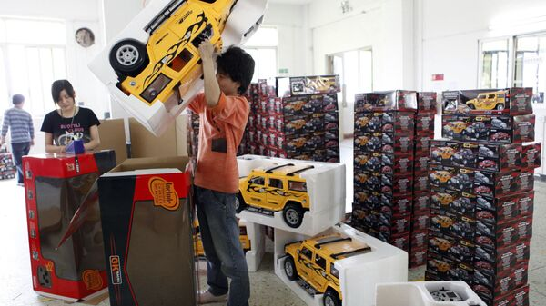 In this photo released by China's Xinhua News Agency, workers pack toys at a factory in Shantou City, south China's Guangdong Province. File photo. - Sputnik International