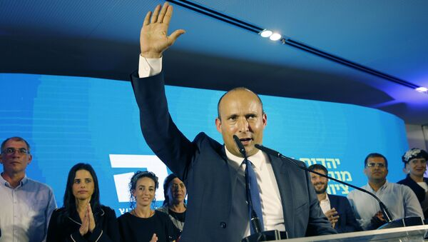 Naftali Bennett (C), member and candidate for the New Right party that is part of the Yamina political alliance, speaks while flanked by party leader Ayelet Shaked (2nd-L), Yamina candidate Ofir Sofer (2nd-R), and and Tkuma party leader and candidate Bezalel Smotrich (3rd-R), at the alliance's headquarters in Ramat Gan, north of Tel Aviv, late on September 17, 2019, as the first exit polls are announced on television. - Israeli Prime Minister Benjamin Netanyahu and his main challenger Benny Gantz were neck-and-neck in the country's general election after polls closed, exit surveys showed. Three separate exit polls carried by Israeli television stations showed Netanyahu's right-wing Likud and Gantz's centrist Blue and White alliance with between 31 and 34 parliament seats each out of 120.  - Sputnik International