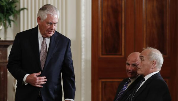 Secretary of State Rex Tillerson arrives to sit in the front row with national security adviser H.R. McMaster, center and White House Chief of Staff John Kelly - Sputnik International
