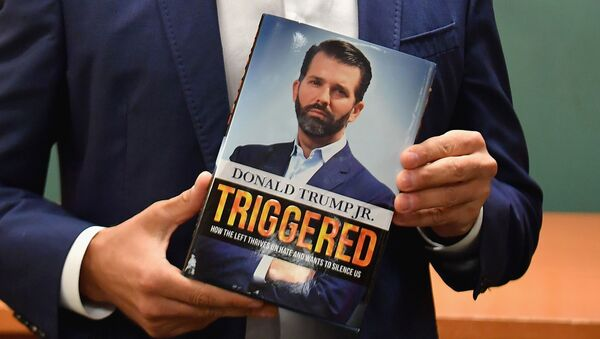 Donald Trump Jr., holds his new Book Triggered: How the Left Thrives on Hate and Wants to Silence Us at Barnes & Noble on 5th Avenue on November 5, 2019 in New York - Sputnik International