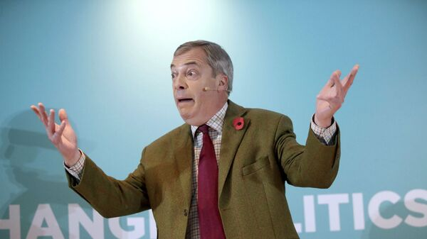 Brexit Party leader Nigel Farage gestures as he delivers a speech to supporters, during an event at the Washington Central Hotel, in Workington, England, Wednesday, Nov. 6, 2019 - Sputnik International