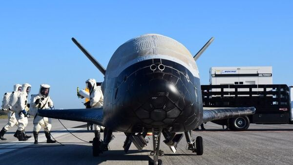 The U.S. Air Force's X-37B Orbital Test Vehicle 4 is seen after at NASA 's Kennedy Space Center Shuttle Landing Facility in Florida May 7, 2017 - Sputnik International