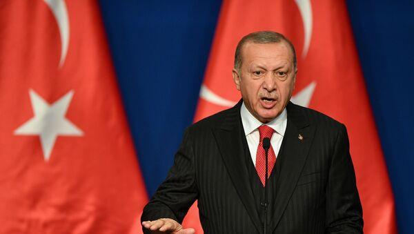Turkish President Recep Tayyip Erdogan speaks during a joint press conference with Hungarian Prime Minister at Varkert Bazar cultural center in Budapest on November 7, 2019 - Sputnik International