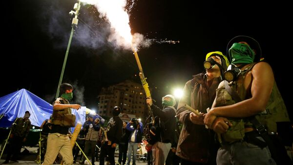 Members of Youth Resistance Cochala set off fireworks to celebrate after Bolivian Senator Jeanine Anez became interim president, following Bolivia's former President Evo Morales' departure from the country, in Cochabanba, Bolivia November 12, 2019 - Sputnik International