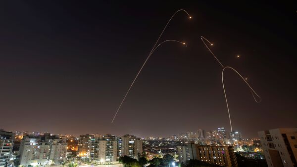 Iron Dome anti-missile system fires interception missiles as rockets are launched from Gaza towards Israel, as seen from the city of Ashkelon, Israel, November 13, 2019 - Sputnik International