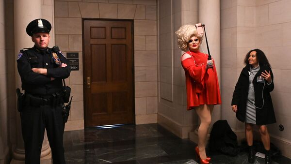 Drag queen Pissi Myles poses in a hallway near the House Intelligence Committee hearing of the impeachment inquiry into U.S. President Donald Trump on Capitol Hill in Washington, U.S., November 13, 2019 - Sputnik International