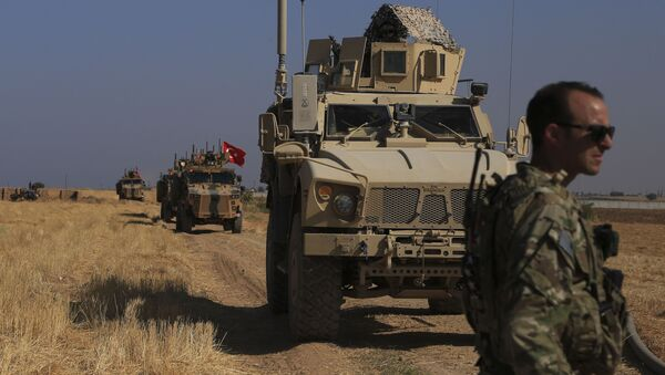 FILE - This Friday, Oct. 4, 2019 file photo, Turkish and American armored vehicles patrol as they conduct joint ground patrol in the so-called safe zone on the Syrian side of the border with Turkey, near the town of Tal Abyad, northeastern Syria - Sputnik International