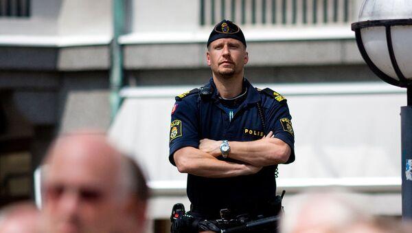 A police officer in Helsingborg (Sweden) - Sputnik International