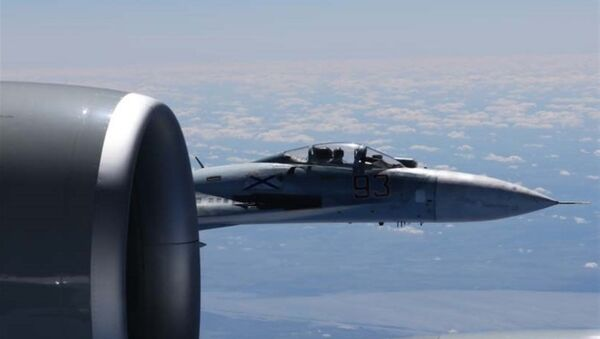 Russian jet and US Air Force reconnaissance jet over the Baltic Sea - Sputnik International