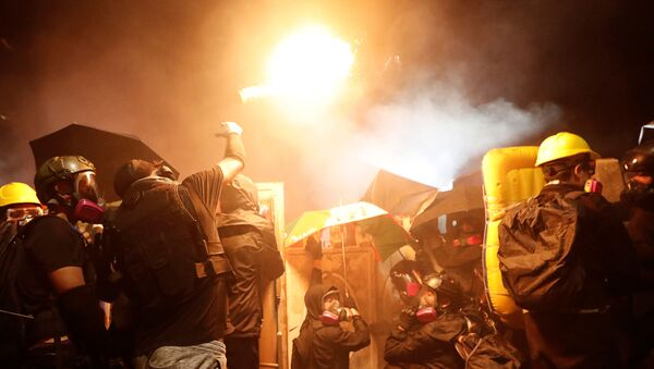 A protesters throws a molotov cocktail during a standoff with riot police at the Chinese University of Hong Kong, Hong Kong, China November 12, 2019 - Sputnik International