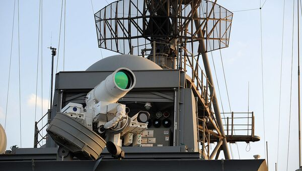 The U.S. Navy Afloat Forward Staging Base (Interim) USS Ponce (AFSB(I)-15) conducts an operational demonstration of the Office of Naval Research (ONR)-sponsored Laser Weapon System (LaWS) while deployed to the Arabian Gulf. - Sputnik International