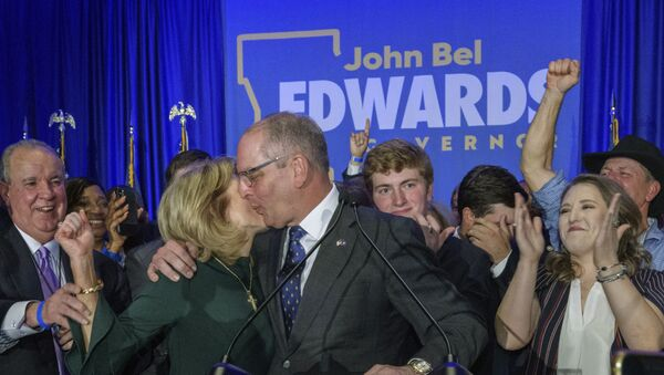 Louisiana Gov. John Bel Edwards celebrates with his wife Donna Edwards as he arrives to address supporters at his election night watch party in Baton Rouge, La., Saturday, Nov. 16, 2019 - Sputnik International