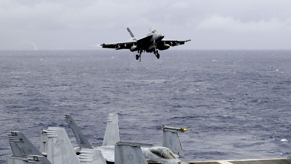 A US fighter jet on the U.S. aircraft carrier in South China Sea. File photo - Sputnik International