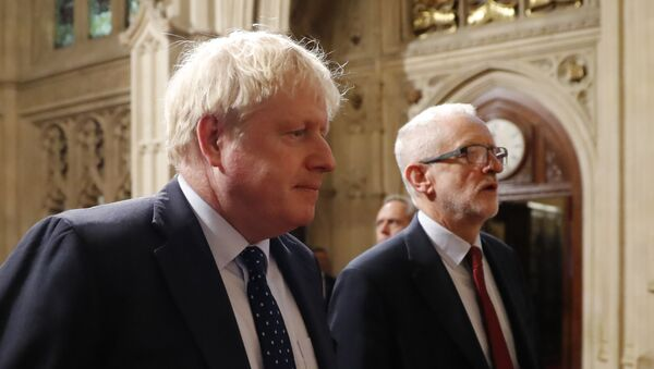 Britain's Prime Minister Boris Johnson (L) and main opposition Labour Party leader Jeremy Corbyn (R) head the procession of members of parliament through the Peers Lobby into the House of Lords to listen to the Queen's Speech during the State Opening of Parliament in the Houses of Parliament in London on October 14, 2019 - Sputnik International