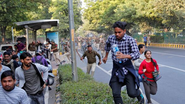 Police wield their batons against students of Jawaharlal Nehru University (JNU) during a protest against a proposed fee hike, in New Delhi, India, November 18, 2019 - Sputnik International
