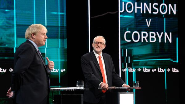 Conservative leader Boris Johnson and Labour leader Jeremy Corbyn are seen during a televised debate ahead of general election in London, Britain, November 19, 2019. - Sputnik International