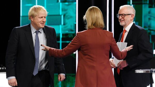 Conservative leader Boris Johnson and Labour leader Jeremy Corbyn are seen during a televised debate ahead of general election in London, Britain, November 19, 2019 - Sputnik International