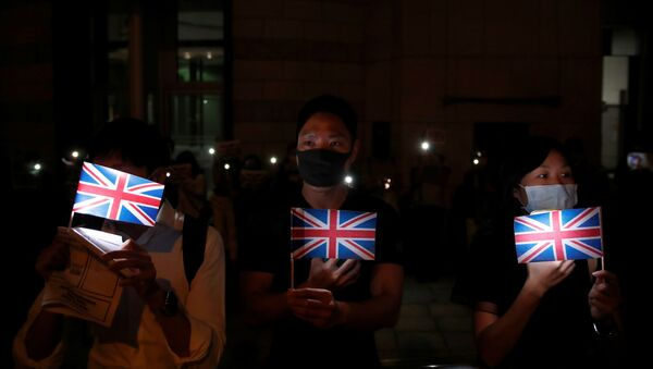 Anti-government demonstrators hold Union Jack flags as they protest in front of the UK consulate in Hong Kong, China, October 23, 2019 - Sputnik International