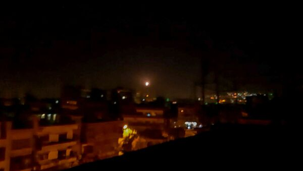Light in the sky, believed to be a missile, is seen the city in Damascus, Syria November 20, 2019 - Sputnik International