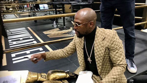Floyd Mayweather signs gloves at the opening of the Mayweather Boxing + Fitness gym in Torrance, California, U.S., November 16, 2019.  Picture taken November 16, 2019 - Sputnik International
