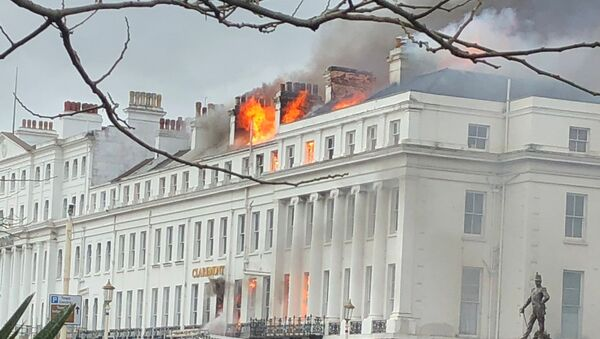 Smoke rises from Claremont Hotel during a fire in Eastbourne, Britain November 22, 2019 in this picture obtained from social media - Sputnik International