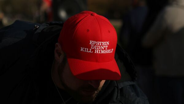 An attendee wears a hat that says Epstein Didn't Kill Himself as militia members and pro-gun rights activists participating in the Declaration of Restoration rally listen to speakers in Washington, D.C., U.S., November 9, 2019 - Sputnik International