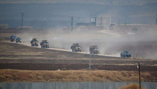 Turkish and Russian military vehicles return following a joint patrol in northeast Syria, as they are pictured from near the Turkish border town of Kiziltepe in Mardin province, Turkey, November 1, 2019. - Sputnik International
