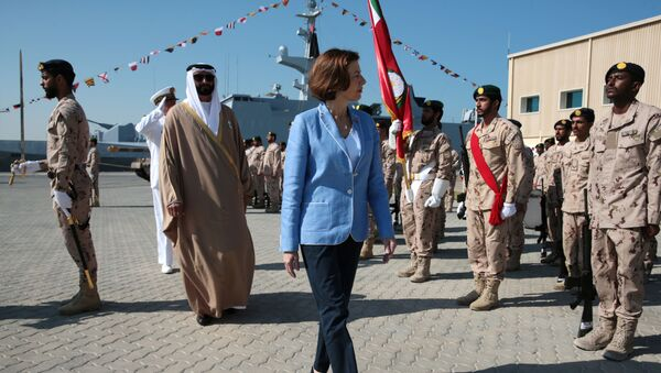 French Defence Minister Florence Parly and United Arab Emirates' Minister of State for Defence Mohammed Bin Ahmad al-Bawardi inspect members of an honour guard during a military ceremony at the French Naval Base in Abu Dhabi, United Arab Emirates November 24, 2019 - Sputnik International