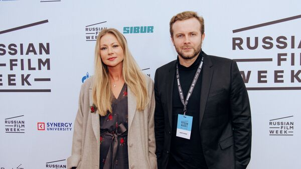Russian director Klim Shipenko and star actress Maria Mironova pose ahead of the screening of the film 'Servant' at the ODEON Luxe Leicester Square in London, UK on 24 November. - Sputnik International