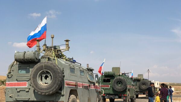 Armoured Russian military police vehicles in the town of Kobani - Sputnik International