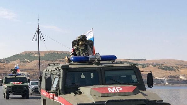 A Russian military police officer near the Euphrates River - Sputnik International